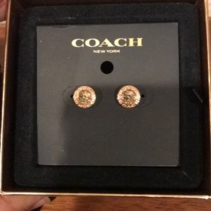 Coach. Gold colored earrings